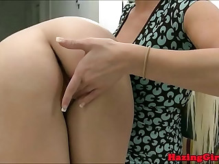 Hazing lesbians fuck a double ended dildo