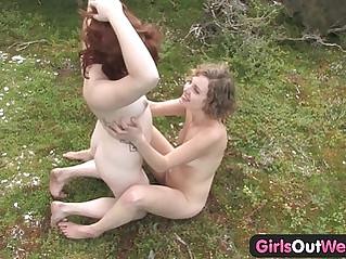 Amateur teen lesbians lick their beavers outdoors